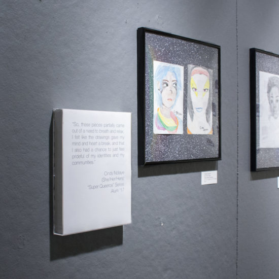 Photograph of multiple pieces (drawings) on a grey wall