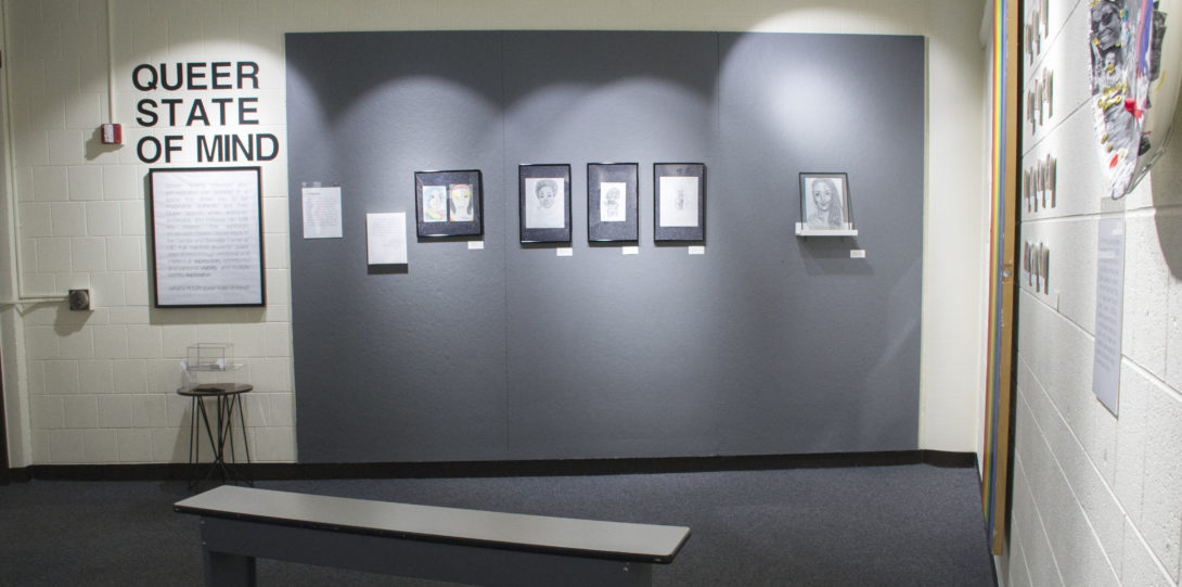 Photograph of the first wall in the exhibition. Title in big black letters reads